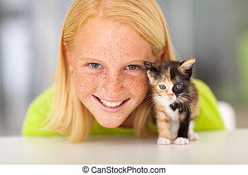 beautiful teen girl with little kitten - beautiful teen girl...