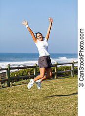 middle aged woman jumping