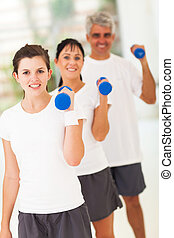 line up of family exercising with dumbbells