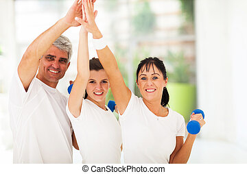 family doing high five after exercising - happy family doing...