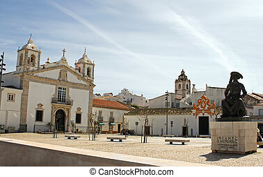 Public square in Faro, Portugal churches in view under a...