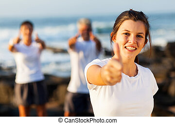 active teenage girl giving thumb up