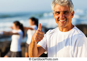mature man giving thumb up - active mature man giving thumb...