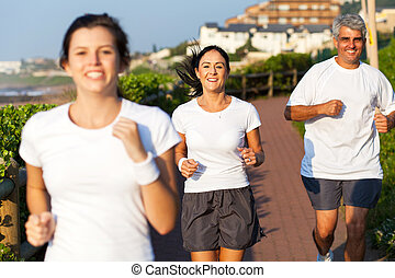 happy active family jogging in the morning