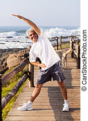 happy senior man doing morning exercise