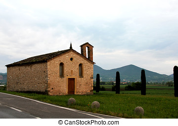 A little church in a field in Italy