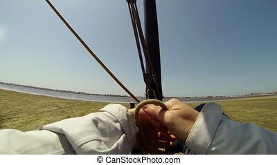 Windcar pilot POV on a sand terrain near the water