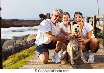 sporty family and pet dog at the beach - sporty family and...