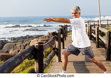 active middle aged man doing morning workout