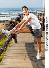 active middle aged woman doing morning exercise