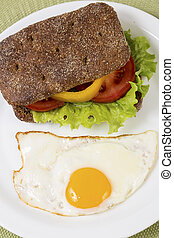 Sandwich with vegetables and half baked egg