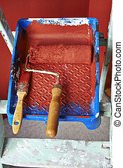Renovations. Painting tools - Renovations. Painting with red...