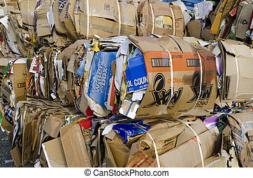 Recycling station - TAIPA, NZ - MAY 03:Stack of old...