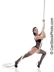Sexy woman in black lingerie posing with rope