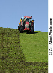Tractor plowing the ground - Red tractor plowing the ground...