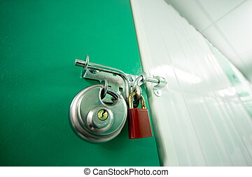 2 Padlocks on a self storage unit - 2 Padlocks ovelocking a...