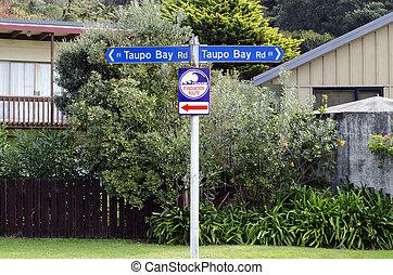 Tsunami evacuation route sign - TAUPO BAY, NZ - MAY...
