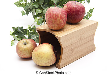 Red apples with wooden container
