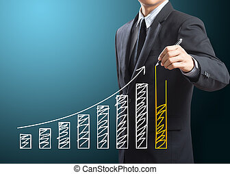Business man drawing growing graph