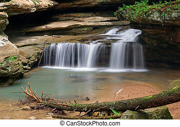 Waterfall at Old Mans Cave - Water plunges over the last of...