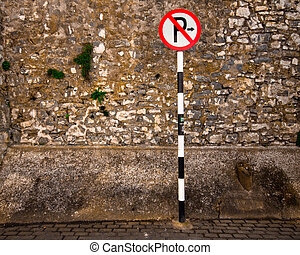 no parking - European no parking sign against rough stone...
