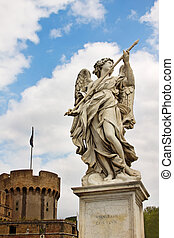 Marble statue of angel with spear by Bernini on Saint Angelo Bridge against the background of Castel Sant'Angelo in Rome, Italy