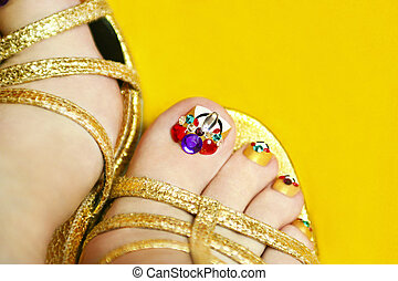 Pedicure. - Pedicure on women's legs with crystals in...