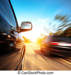 high-speed car - A car driving on a motorway at high speeds,...