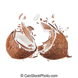 Coconut - Fresh coconut with flying pieces, isolated on...