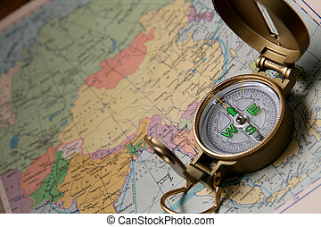 Compass On Map - A compass on the world map of the atlas