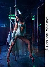 Pole dance woman - Striptease in night club . Pole dance...
