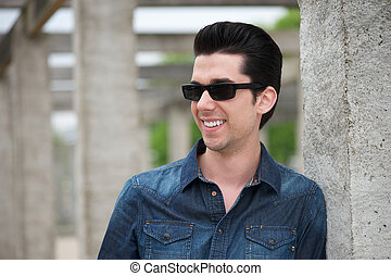 Attractive young man outdoors with sunglasses