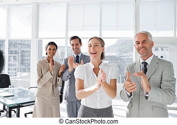 Group of business people applauding together in the meeting...
