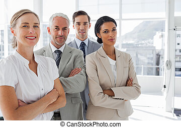 Smiling business people standing to