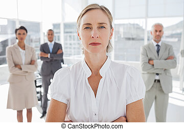 Serious businesswoman standing with