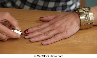 Woman apply red nail polish episode 2