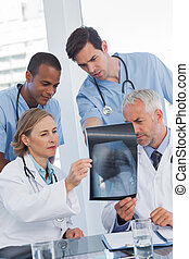 Serious medical team examining radiography