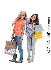 Two friends holding shopping bags
