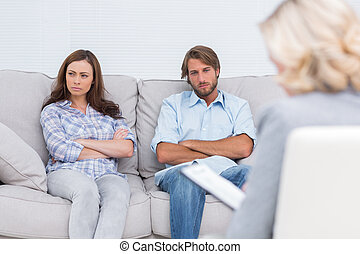 Young couple going through therapy and listening to the...