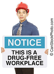 Drug Free Workplace - A man holding a notice sign announcing...