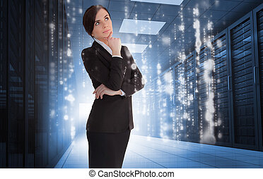 Businesswoman contemplating in data center with falling...