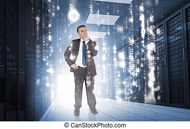 Businessman thinking in data center