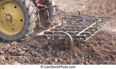 agriculture tractor plowing field - agriculture tractor...