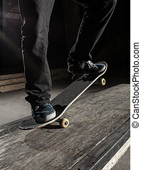 Close up of skater doing manual trick on the manual pad in...