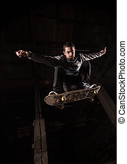Low angle view of skater mid air doing ollie trick in the...
