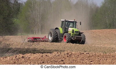 big tractor plowed spring field