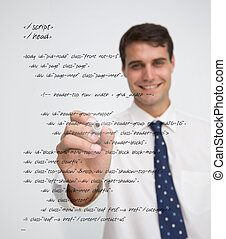 Smiling businessman writing in sql language on a transparent...