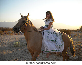Wind blown girl on horse