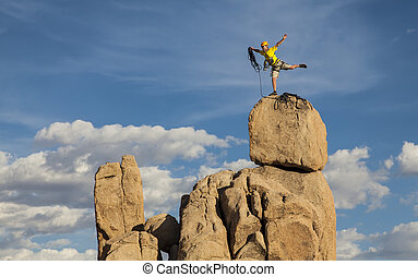 Climber on the summit - Rock climber balances on the summit...