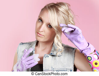 blond woman wearing latex gloves - cute young woman wearing...